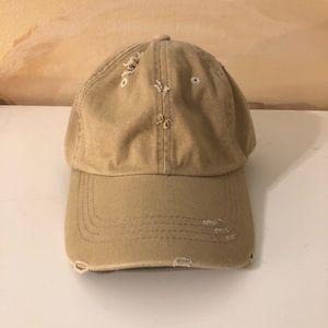 Ripped tan hat